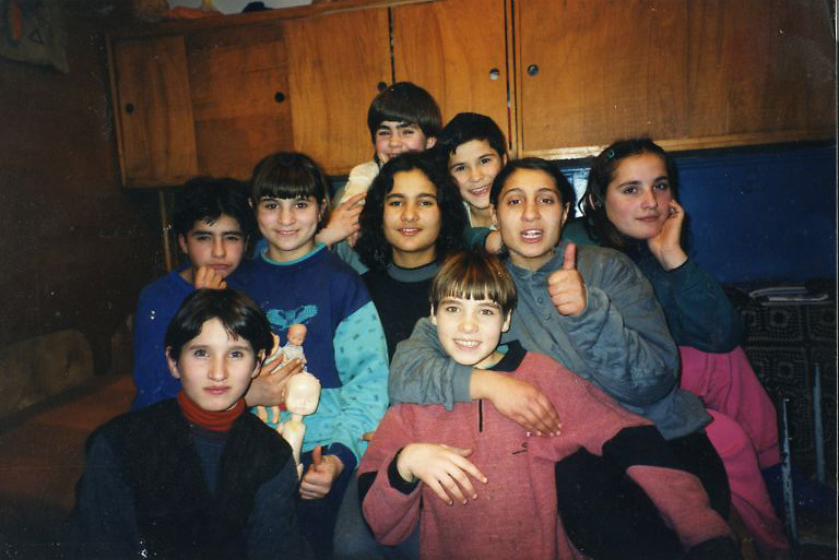 Rodica (right) in 1997 at the Popricani orphange where she grew up