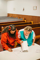 LaFollette, TN - Nov. 14, 2013: Flossie Brumitte, left, and Nana Lou Meadors sign a petition supporting Tabernacle Church of God's right to handle serpents. The church, whose congregation regularly handles snakes as part of services, had their snakes confiscated in early November by the Tennessee Wildlife Resources Agency for violating a Tennessee law against handling serpents in church. <br /> <br /> Photo by Shawn Poynter