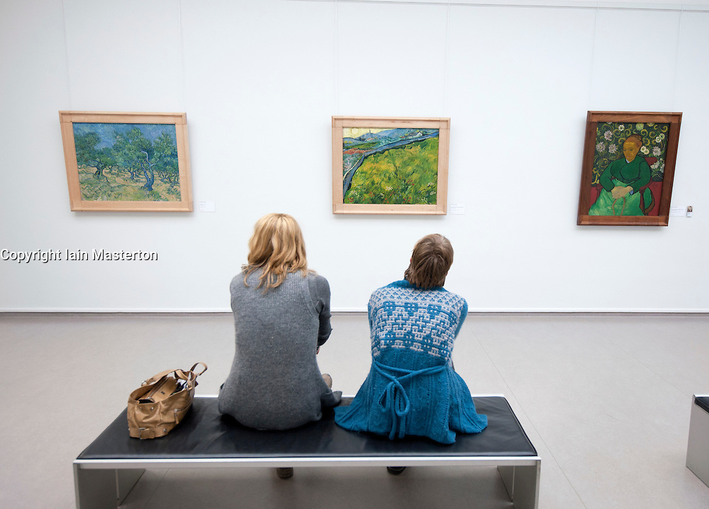 Women looking at paintings by Vincent van Gogh at Kroller-Muller Museum in The Netherlands