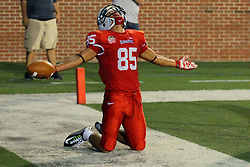 06 Sep 2014: Lechein Neblett kneels on the white out of bounds stripe at the back of the end zone and extends his arms in celebration after scoring on a pass reception during a non-conference NCAA football game between the Delta Devils of Mississippi Valley State and the Redbirds of Illinois State at Hancock Stadium in Normal Il