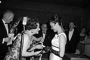 8/04/1965<br /> 04/28/1965<br /> 28 April 1965<br /> Festival of Kerry Dublin Ball at the Gresham Hotel, Dublin. Photo shows winner Miss Irene Courtney (right) receiving her award from Frances McDermott (hidden) and Mrs Nanette Barrett, Chairman, Dublin Committee.