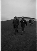 Taoiseach Visits Newgrange.  (R70)..1987..21.12.1987..12.21.1987..21st December 1987..An Taoiseach, Charles Haughey TD, visited the Newgrange Stoneage Chamber to view thwe annual Winter Soltice. As the sun rose, An Taoiseach watched as the sunrise traced its path along the floor of the chamber...With the Newgrange site in the back ground An Taoiseach , Charles Haughey, and the tour guide make their way back to the Newgrange Visitors Centre for a welcome tea or coffee.