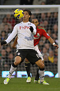 Picture by David Horn/Focus Images Ltd +44 7545 970036.29/12/2012.Bryan Ruiz of Fulham and y of Swansea City during the Barclays Premier League match at Craven Cottage, London.