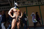 A foreign man naked apart from a Batman mask and loincloth with attached phallus poses during the Kanamara matsuri or festival of the iron phallus in Kawasaki Daishi near Tokyo, Japan. Sunday April 1st 2012
