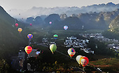 Fire Balloons Fly Above Karst During International Mountain Tourism Conference