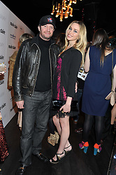 SCOT YOUNG and NOELLE RENO at a party to celebrate the launch of the Marie Claire Runway Magazine held at Le Baron a The Embassy, Old Burlington Street, London on 1st February 2012.