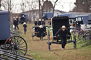 Amish men push a buggy home following the Annual Mud Sale to support the Fire Department in Gordonville, PA.