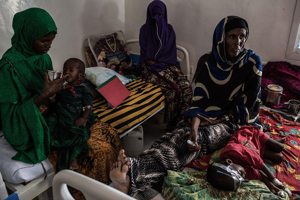 Women and children sit inside the malnutrition ward at Garowe General Hospital on February 27, 2017 in Garowe, Somalia.