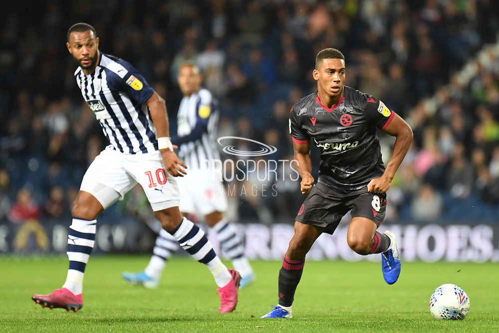 Reading midfielder Andy Rinomhota (8)  looks for options during the EFL Sky Bet Championship match between West Bromwich Albion and Reading at The Hawthorns, West Bromwich, England on 21 August 2019.
