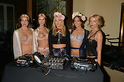 Centre, LAURA WHITMORE with models at a party to celebrate the 15th anniversary of Myla held at the House of Myla, 8-9 Stratton Street, London on 21st October 2014.