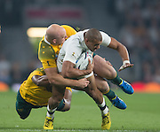 Twickenham, Great Britain,    Jonathan JOSEPH, tackled, during the Pool A game, England vs Australia.  2015 Rugby World Cup, Venue, RFU Stadium, Twickenham, Surrey, ENGLAND.  Saturday  03/10/2015<br /> Mandatory Credit; Peter Spurrier/Intersport-images]