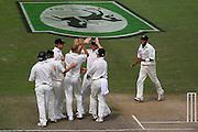The Black Caps congratulate Chris Martin on the dismissal of Matthew Hoggard.<br /> National Bank Test Match Series, New Zealand v England, 1st Test at Seddon Park, Hamilton, New Zealand. Day 5. Sunday, 9 March 2008. Photo: Dave Lintott/PHOTOSPORT