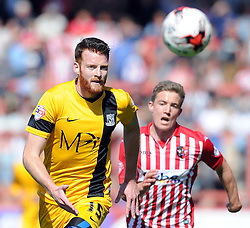 Southend United's Cian Bolger is tackled by Exeter City's David Wheeler - Photo mandatory by-line: Harry Trump/JMP - Mobile: 07966 386802 - 18/04/15 - SPORT - FOOTBALL - Sky Bet League Two - Exeter City v Southend United - St James Park, Exeter, England.