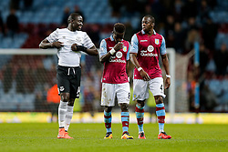 Oumar Niasse of Everton looks on as Idrissa Gueye and Aly Cissokho of Aston Villa look dejected after Everton win 1-3 - Mandatory byline: Rogan Thomson/JMP - 01/03/2016 - FOOTBALL - Villa Park Stadium - Birmingham, England - Aston Villa v Everton - Barclays Premier League.