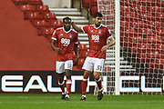 Nottingham Forest midfielder Andreas Bouchalakis (31) pats Nottingham Forest midfielder Mustafa Carayol (18)  on the head after putting the Reds 1-0 up during the EFL Cup match between Nottingham Forest and Shrewsbury Town at the City Ground, Nottingham, England on 8 August 2017. Photo by Jon Hobley.