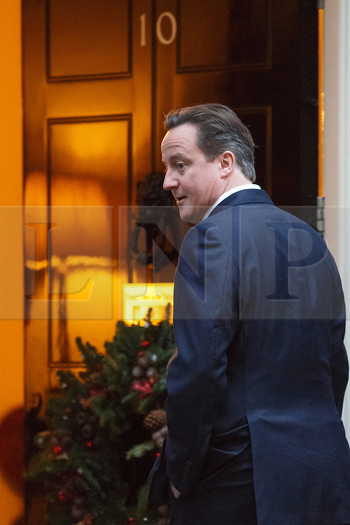 © licensed to London News Pictures. London, UK 17/12/2013. Prime Minister David Cameron walking to No10 on Downing Street on Tuesday, December 17, 2013. Photo credit: Tolga Akmen/LNP