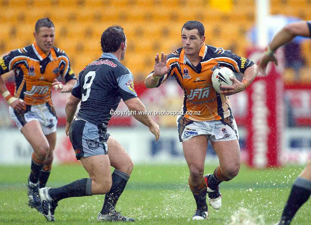 Tigers 2nd row Ben Galea fends off hooker Lance Hohaia during round 12 of the NRL Rugby League match between the New Zealand Warriors and Wests Tigers at Ericsson Stadium, Auckland, New Zealand, on Sunday 29 May, 2005. The Warriors won the match 21-4. EDITORIAL USE ONLY. Photo: Renee McKay/PHOTOSPORT<br />