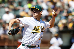 OAKLAND, CA - MAY 01: Rich Hill #18 of the Oakland Athletics pitches against the Houston Astros during the third inning at the Oakland Coliseum on May 1, 2016 in Oakland, California. (Photo by Jason O. Watson/Getty Images) *** Local Caption *** Rich Hill