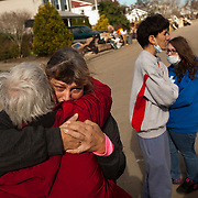 "Vicki Hagman hugs her sister Judy as Judy takes away her dogs on a street littered with debris and wreckage left by Superstorm Sandy in Union Beach NJ, The storm destroyed Vicki's home, forcing her to move in with another sister: ""We have six people and four dogs staying in a small house. It was too much. I have to send them away."" she said, barely holding back tears.The storm-surge from Superstorm Sandy destroyed several oceanfront blocks of Union Beach, leveling homes or lifting them off their foundations, breaking them apart and moving them."