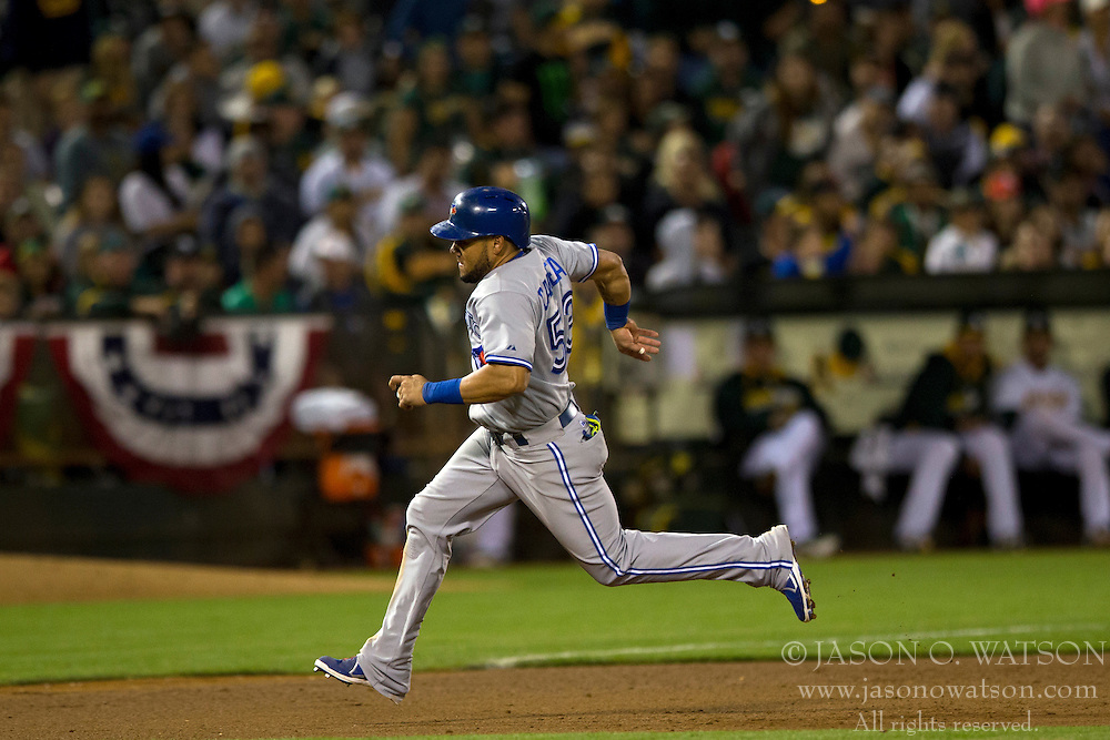 OAKLAND, CA - JULY 05:  Melky Cabrera #53 of the Toronto Blue Jays rounds third base against the Oakland Athletics during the eighth inning at O.co Coliseum on July 5, 2014 in Oakland, California. The Oakland Athletics defeated the Toronto Blue Jays 5-1.  (Photo by Jason O. Watson/Getty Images) *** Local Caption *** Melky Cabrera