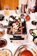 Enjoying horumon-yaki at a restaurant in Tsuruhashi/Korea Town.