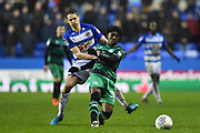 Eberechi Eze (30) of Queens Park Rangers battles for possession with Dave Edwards (16) of Reading during the EFL Sky Bet Championship match between Reading and Queens Park Rangers at the Madejski Stadium, Reading, England on 30 March 2018. Picture by Graham Hunt.