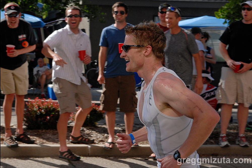 Kyle Grisham receives encouragement along the run course during the Ironman 70.3 Boise event on June 12, 2010 in Boise, Idaho. Grisham finished the 1.2 mile swim, 56 mile bike, and 13.1 mile run in 5:42:52.