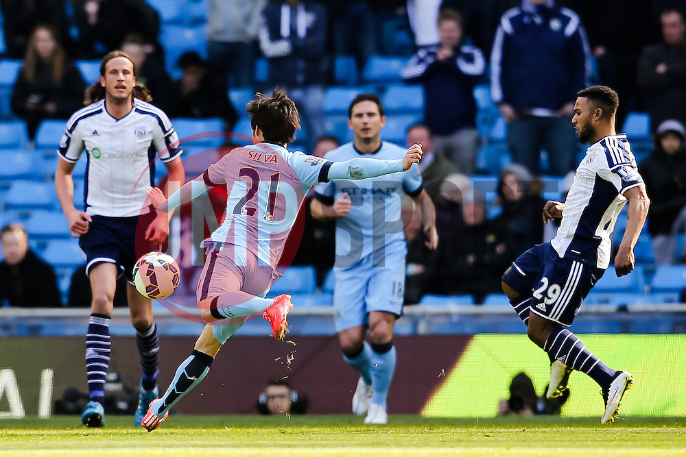 Manchester City's David Silva fires a shot towards goal  - Photo mandatory by-line: Matt McNulty/JMP - Mobile: 07966 386802 - 21/03/2015 - SPORT - Football - Manchester - Etihad Stadium - Manchester City v West Bromwich Albion - Barclays Premier League
