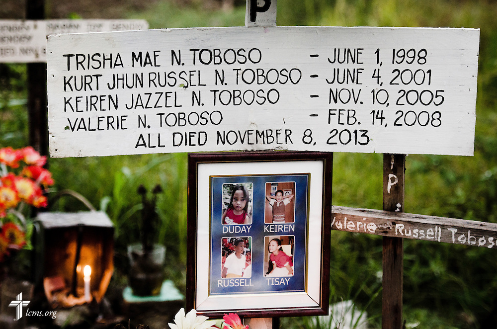 Four children from a family perished amongst thousands from Typhoon Haiyan, pictured on a marker in a graveyard in Tacloban, Leyte Province, Philippines, on Friday, March 14, 2014. LCMS Communications/Erik M. Lunsford