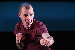 "© Licensed to London News Pictures. 19/11/2014. London, England. Actor Tom Vaughan-Lawlor performs as The Howie Lee/The Rookie Lee in the one-man play ""Howie the Rookie"" by Mark O'Rowe at the Barbican's Pit Theatre, London, UK. The Landmark Productions play is directed by Mark O'Rowe runs from 19 to 29 November 2014 in the Pit, Barbican Centre. Photo credit: Bettina Strenske/LNP"