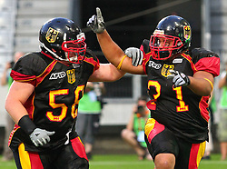 08.07.2011, Tivoli Stadion, Innsbruck, AUT, American Football WM 2011, Group A, Germany (GER) vs Mexico (MEX), im Bild Hannes Irmer (Germany, #58, OL) and Jerome Morris (Germany, #31, RB) are celebrating after the touchdown // during the American Football World Championship 2011 Group A game, Germany vs Mexico, at Tivoli Stadion, Innsbruck, 2011-07-08, EXPA Pictures © 2011, PhotoCredit: EXPA/ T. Haumer