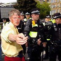 Anti G8 protestors block King George V bridge at the Broomielaw, Glasgow...A protestor argues with the Police.