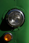 Close up detail of headlight and indicator, green bus