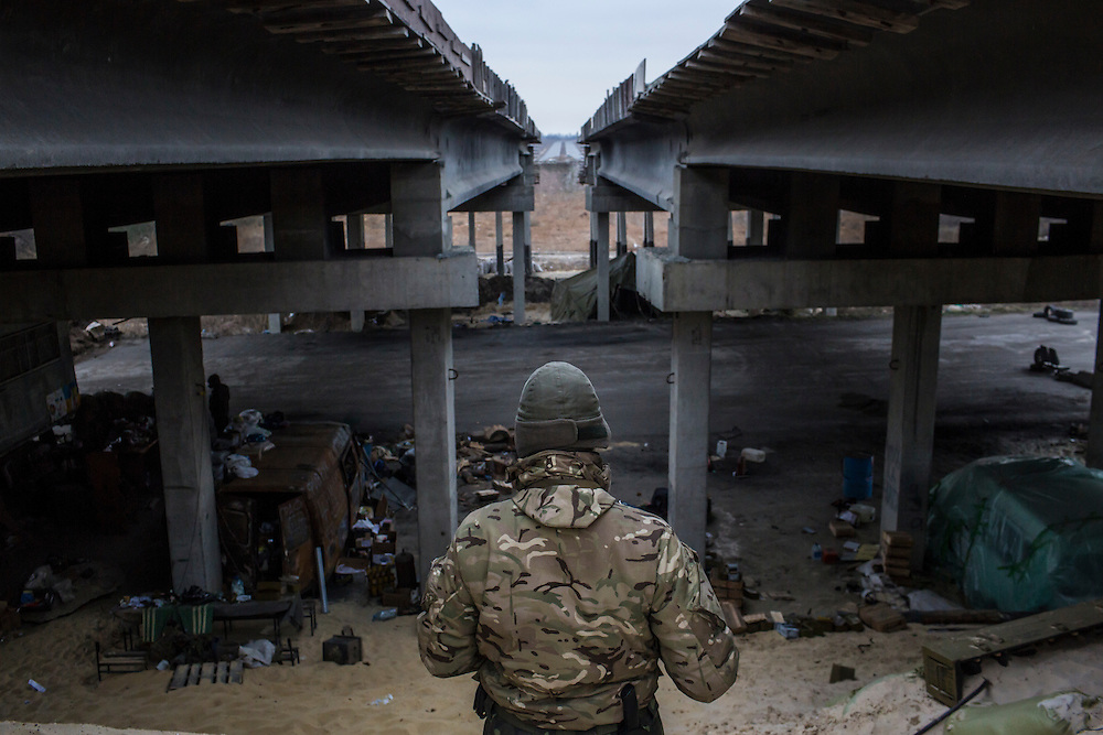 PERVOMAISKE, UKRAINE - NOVEMBER 17, 2014: Grigoriy Matyash, a member of the 5th platoon of the Dnipro-1 brigade, a pro-Ukraine militia, at their post underneath a bridge in Pervomaiske, Ukraine. CREDIT: Brendan Hoffman for The New York Times