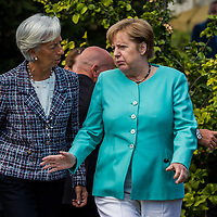 Taormina 27-05-2017 G7, Final Photofamily of the Leaders; Christine Lagarde and Angela Merkel