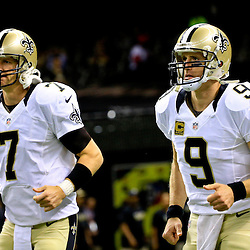 Oct 15, 2015; New Orleans, LA, USA; New Orleans Saints quarterback Luke McCown (7) and quarterback Drew Brees (9) before a game against the Atlanta Falcons at the Mercedes-Benz Superdome. Mandatory Credit: Derick E. Hingle-USA TODAY Sports