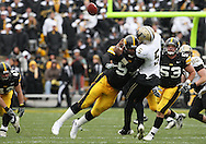 15 NOVEMBER 2008: Purdue quarterback Justin Siller (5) is hit by Iowa defensive end Adrian Clayborn (94) as he throws the ball in the first half of an NCAA college football game against Purdue, at Kinnick Stadium in Iowa City, Iowa on Saturday Nov. 15, 2008. Iowa beat Purdue 22-17.