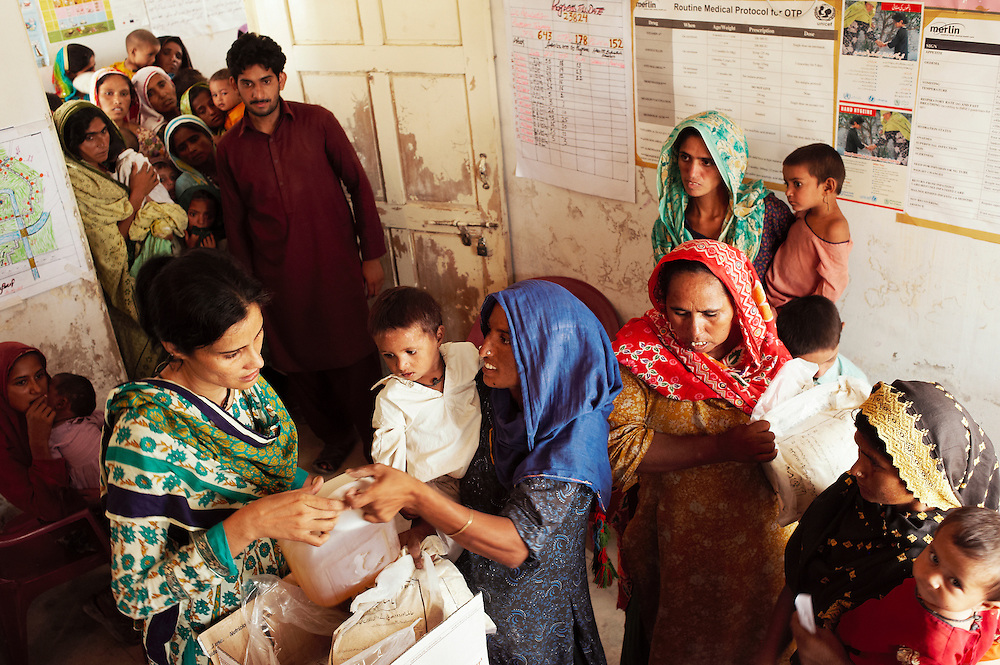 Patients seeks treatment from lady health visitors at the Mitho Barbar government health clinic in Dadu, Sindh, Pakistan on July 4, 2011.