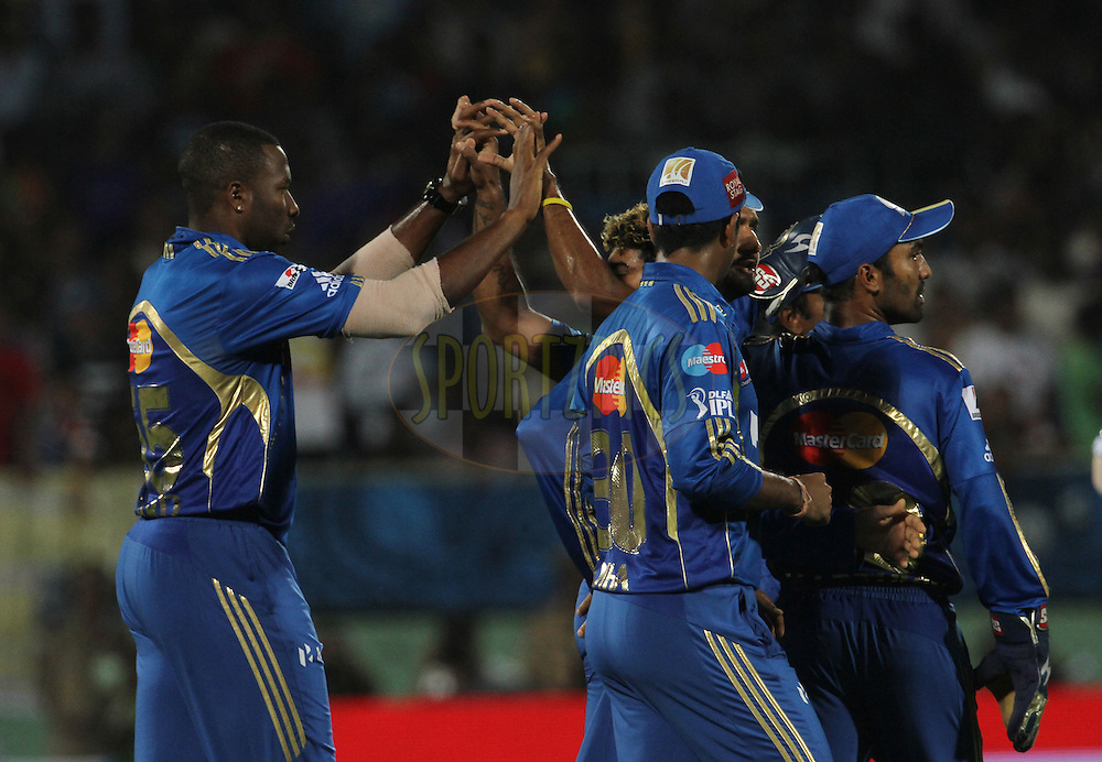 Mumbai Indian players celebrates after the wicket of Deccan Chargers player Shikhar Dhawan during match 9 of the the Indian Premier League ( IPL) 2012  between The Deccan Chargers and the Mumbai Indians held at the ACA-VDCA Stadium, Visakhapatnam on the 9th April 2012..Photo by Vipin Pawar/IPL/SPORTZPICS