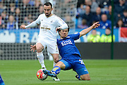 Leicester City forward Shinji Okazaki tackles Swansea City midfielder Leon Britton during the Barclays Premier League match between Leicester City and Swansea City at the King Power Stadium, Leicester, England on 24 April 2016. Photo by Alan Franklin.