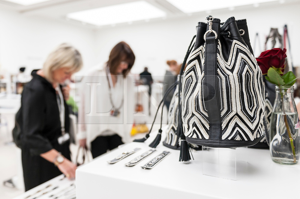 © Licensed to London News Pictures. 22/02/2016. London, UK.  A duffle bag by Buba on display as Scoop London takes place at the Saatchi Gallery in Chelsea.  Running concurrently with London Fashion Week AW16, the show attracts fashion buyers from around the world who come to meet designers presenting their products amongst the gallery's artworks. Photo credit : Stephen Chung/LNP