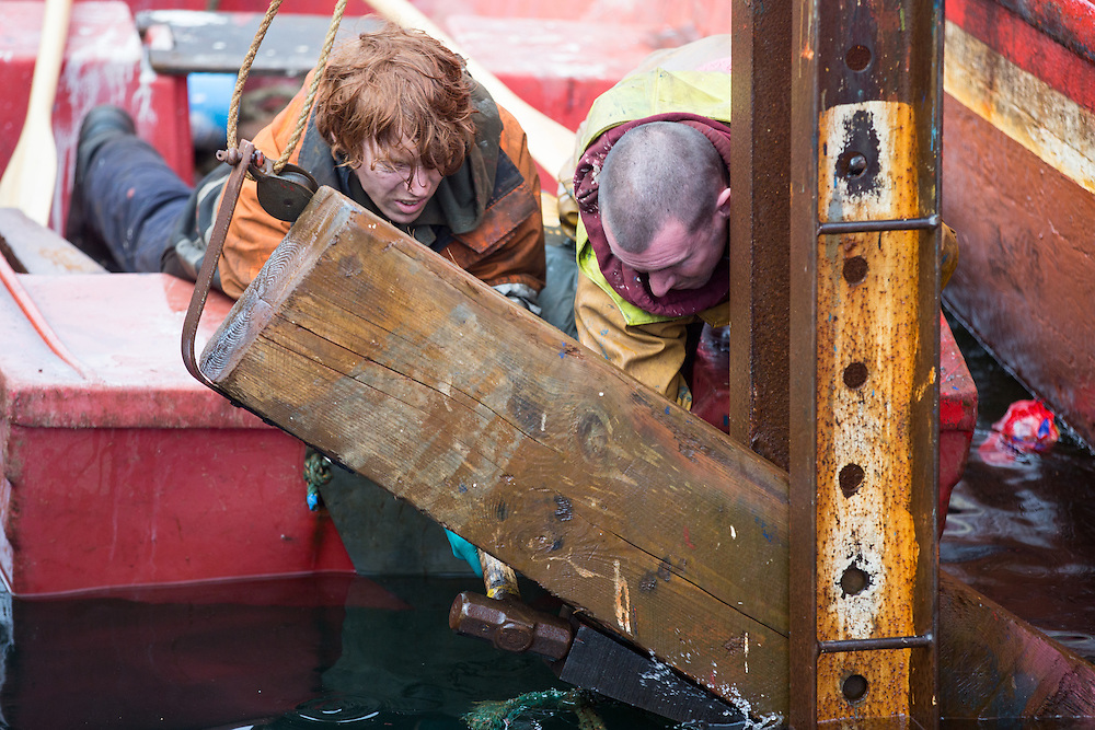 Mallaig Boatyard.  Painter/ Labourer Scott Gibson (L) and CJ attach the Ranger to the cradle. Picture Robert Perry 9th April 2016<br /> <br /> Must credit photo to Robert Perry<br /> FEE PAYABLE FOR REPRO USE<br /> FEE PAYABLE FOR ALL INTERNET USE<br /> www.robertperry.co.uk<br /> NB -This image is not to be distributed without the prior consent of the copyright holder.<br /> in using this image you agree to abide by terms and conditions as stated in this caption.<br /> All monies payable to Robert Perry<br /> <br /> (PLEASE DO NOT REMOVE THIS CAPTION)<br /> This image is intended for Editorial use (e.g. news). Any commercial or promotional use requires additional clearance. <br /> Copyright 2014 All rights protected.<br /> first use only<br /> contact details<br /> Robert Perry     <br /> 07702 631 477<br /> robertperryphotos@gmail.com<br /> no internet usage without prior consent.         <br /> Robert Perry reserves the right to pursue unauthorised use of this image . If you violate my intellectual property you may be liable for  damages, loss of income, and profits you derive from the use of this image.