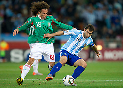 Andres Guardado of Mexico vs Javier Mascherano of Argentina during the 2010 FIFA World Cup South Africa Round of Sixteen match between Argentina and Mexico at Soccer City Stadium on June 27, 2010 in Johannesburg, South Africa. Argentina defeated Mexico 3-1 and qualified for quarterfinals. (Photo by Vid Ponikvar / Sportida)