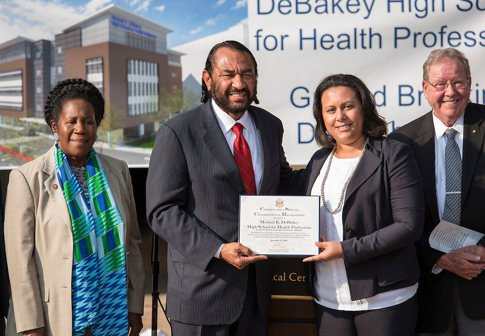 Representatives Sheila Jackson-Lee and Al Green present a Congressional Recognition to Natalie Bell-Frederick during a groundbreaking ceremony for the new DeBakey High School for Health Professionals, December 15, 2014.