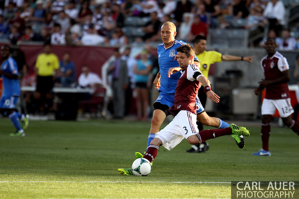 June 15th, 2013 - Colorado Rapids defender Drew Moor (3) attempts to clear the ball down field past San Jose Earthquake forward Steven Lenhart (16) in the first half of action in the MLS match between San Jose Earthquake and the Colorado Rapids at Dick's Sporting Goods Park in Commerce City, CO