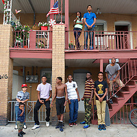 Children and teens, aged 1-17, who reside in downtown Atlantic City, in view of the Trump casino, congregate on an apartments stairs for a portrait in Atlantic City, NJ on September 4, 2014.  4 casinos have already or will be closing in the near future.