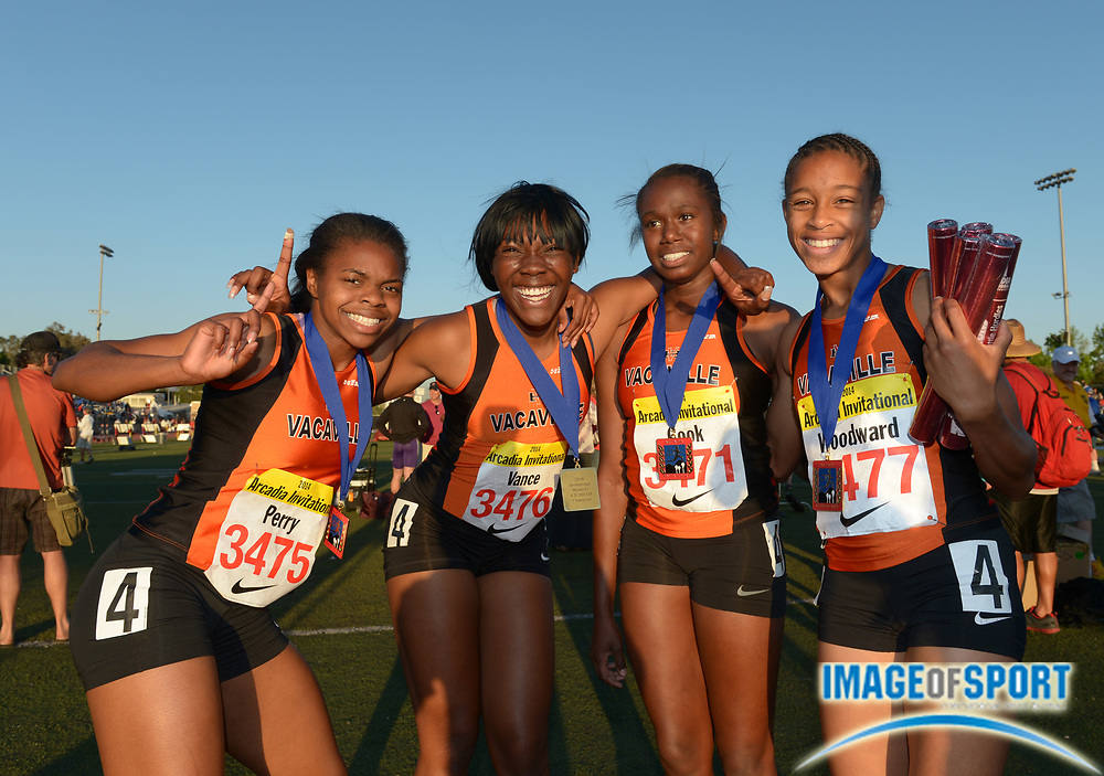 Apr 11, 2014; Arcadia, CA, USA; Members of the Vacaville girls 4 x 100m shuttle hurdles relay pose after winning in a national record 57.17 in the 47th Arcadia Invitational at Arcadia High. From left: Patrianna Perry and Nia Vance and Daria Cook and Jurnee Woodward.