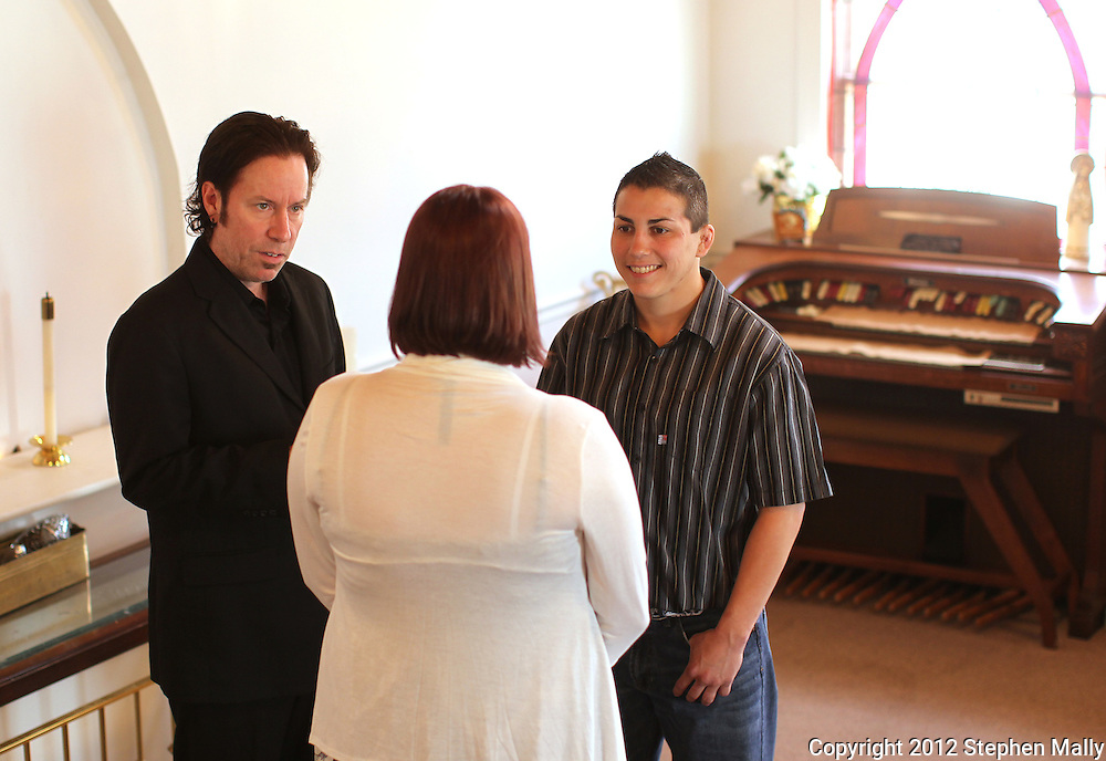 Rev. Jonathan Harnish (from left) marries Brigg McDonald and Stephany Lee at a wedding chapel in Cedar Rapids on Monday, April 23, 2012.