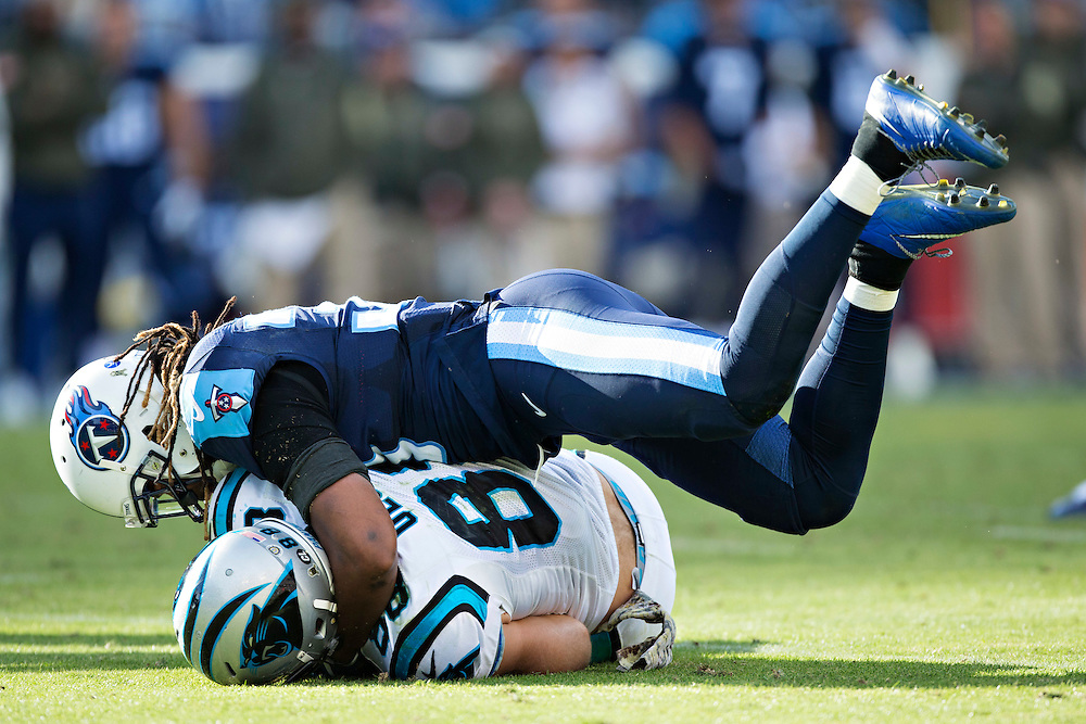 NASHVILLE, TN - NOVEMBER 15:  Michael Griffin #33 of the Tennessee Titans tackles Greg Olsen #88 of the Carolina Panthers at Nissan Stadium on November 15, 2015 in Nashville, Tennessee.  (Photo by Wesley Hitt/Getty Images) *** Local Caption *** Michael Griffin; Greg Olsen