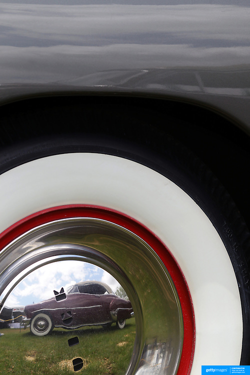 A 1949 Buick Super 51 hub cap reflecting a 1952 Chevrolet Belair Deluxe at the Greenwich Concours d'Elegance Festival of Speed and Style featuring great classic vintage cars. Roger Sherman Baldwin Park, Greenwich, Connecticut, USA.  2nd June 2012. Photo Tim Clayton